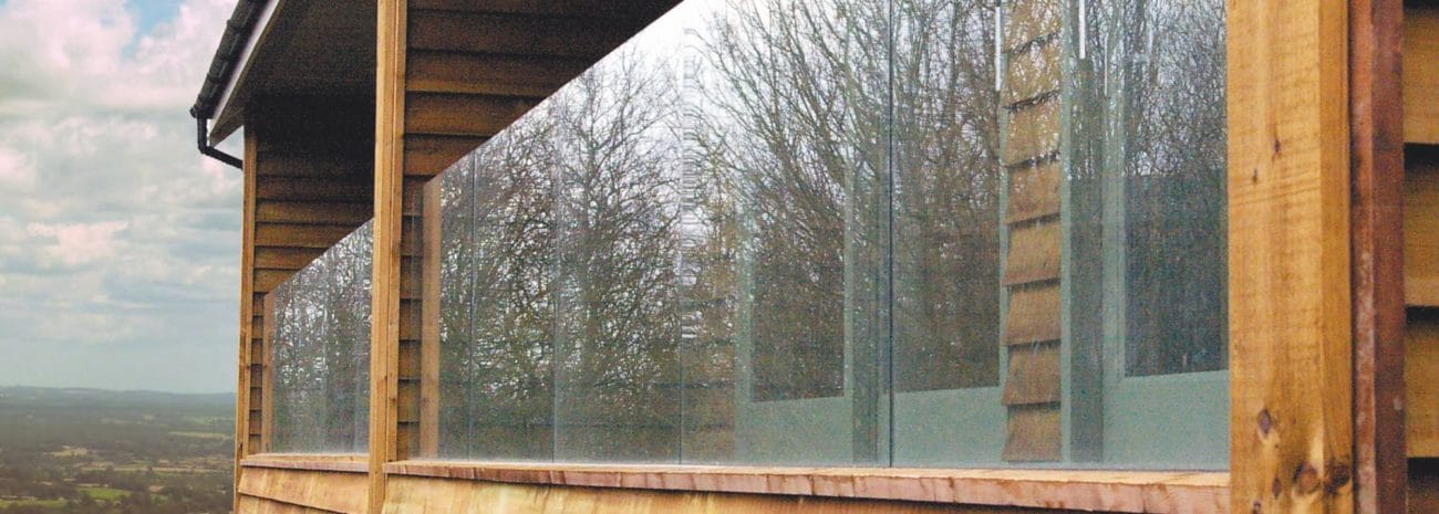 Photo of Glass Balustrade installed on a contemporary wooden clad home