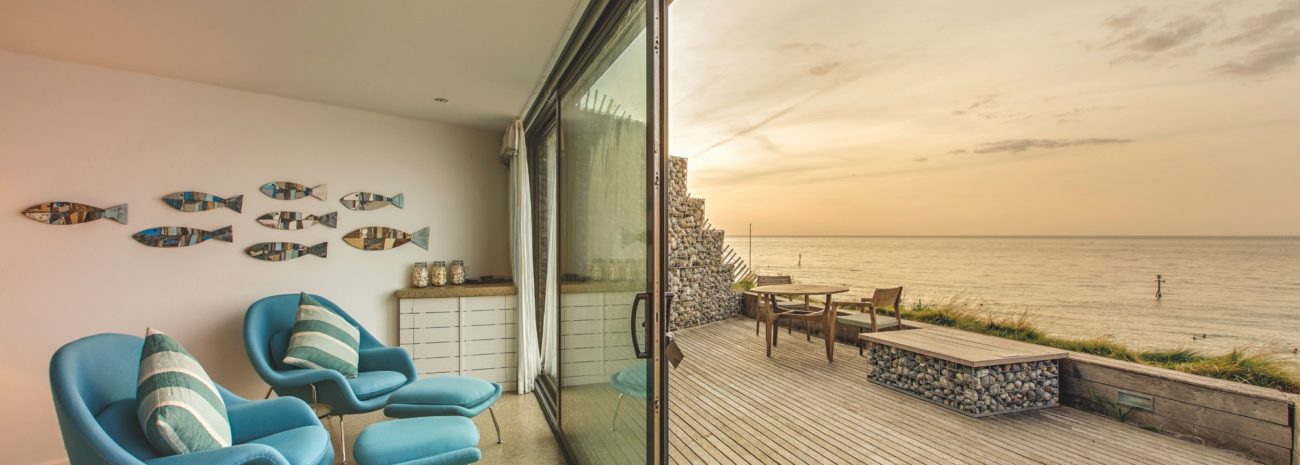 Photo showing the Grand Slider II Sliding door on a house next to the sea in Norfolk