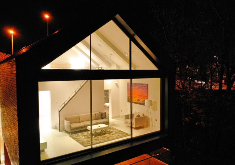 Gable end glazing above sliding doors