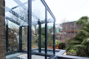 Lean-to glass roof above fixed frame glazing