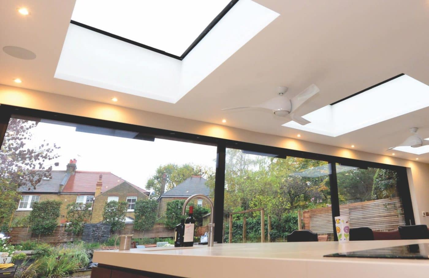 Photo showing a light contemporary room that shows the effectiveness of IDSystems roof-lights