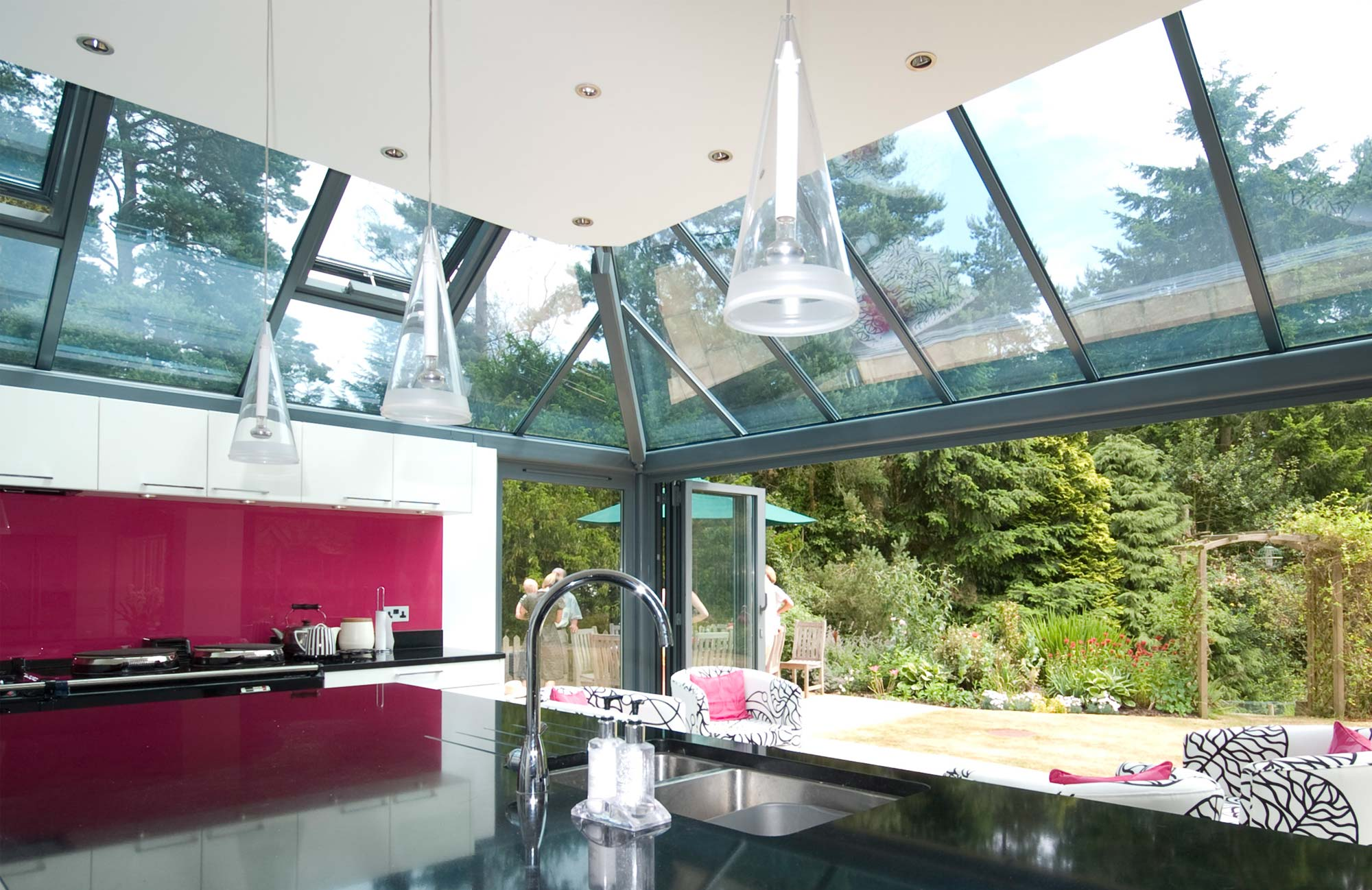Glass roofs over bifold doors