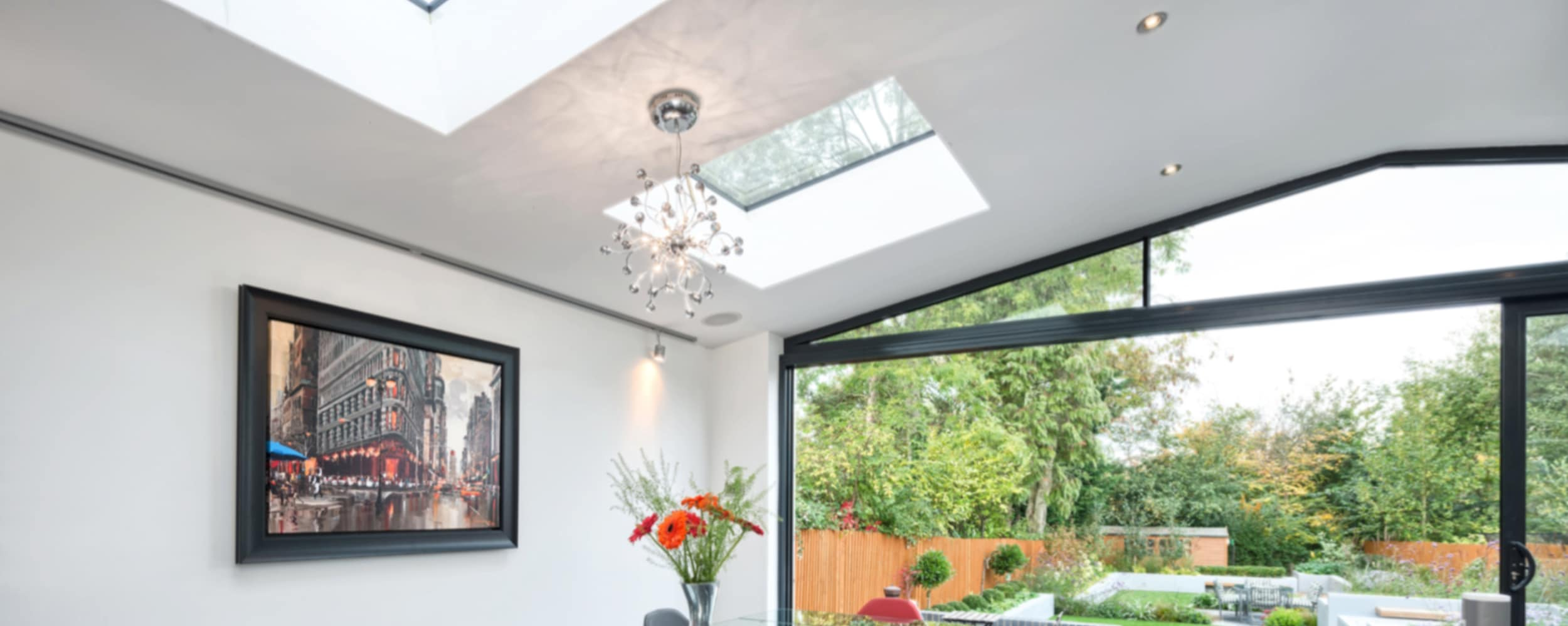Room showing different installations from IDSystems including roof-lights, gable end windows and theEDGE2.0 sliding door