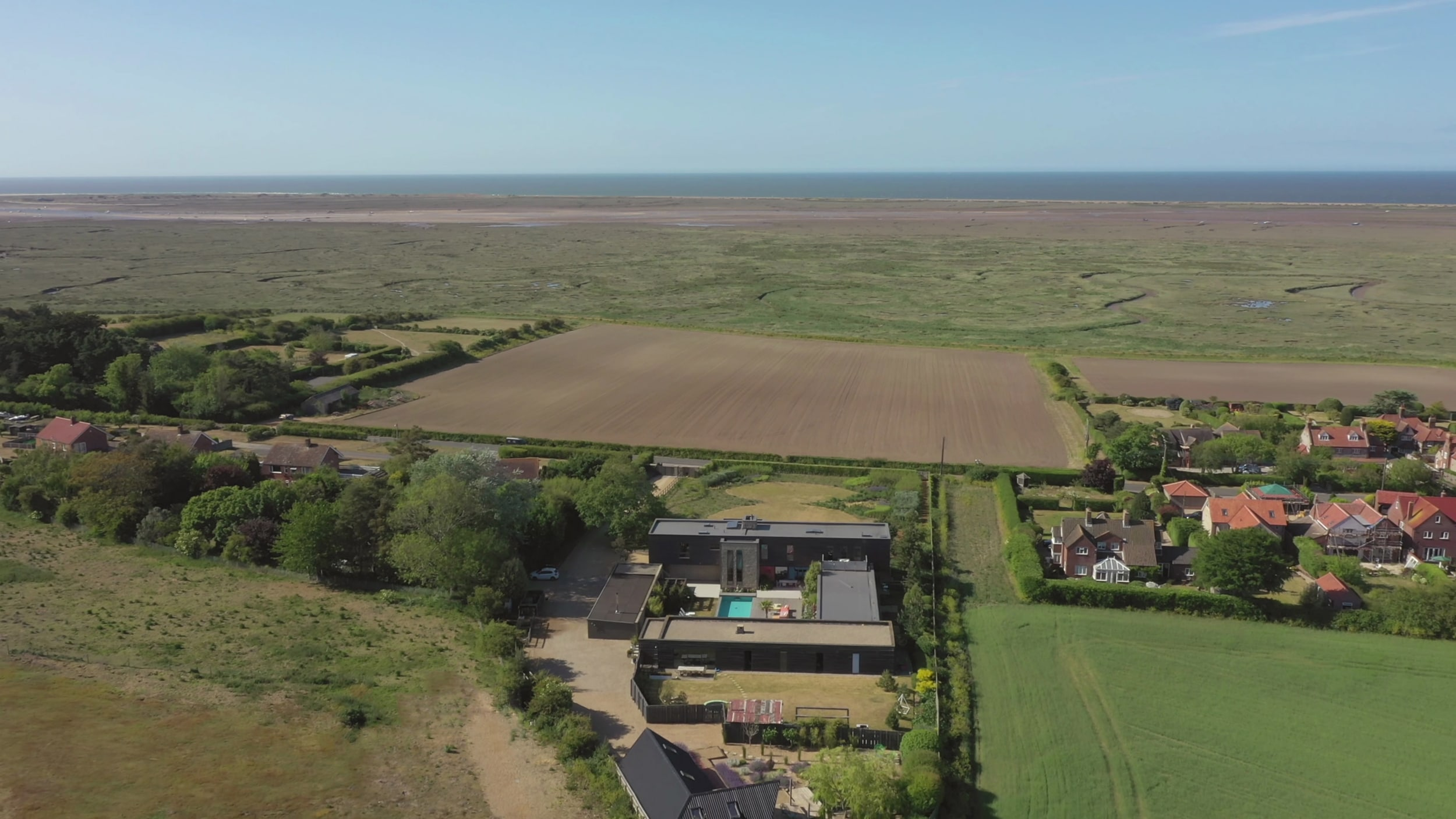 The unspoiled views out over the salt marshes to the sea