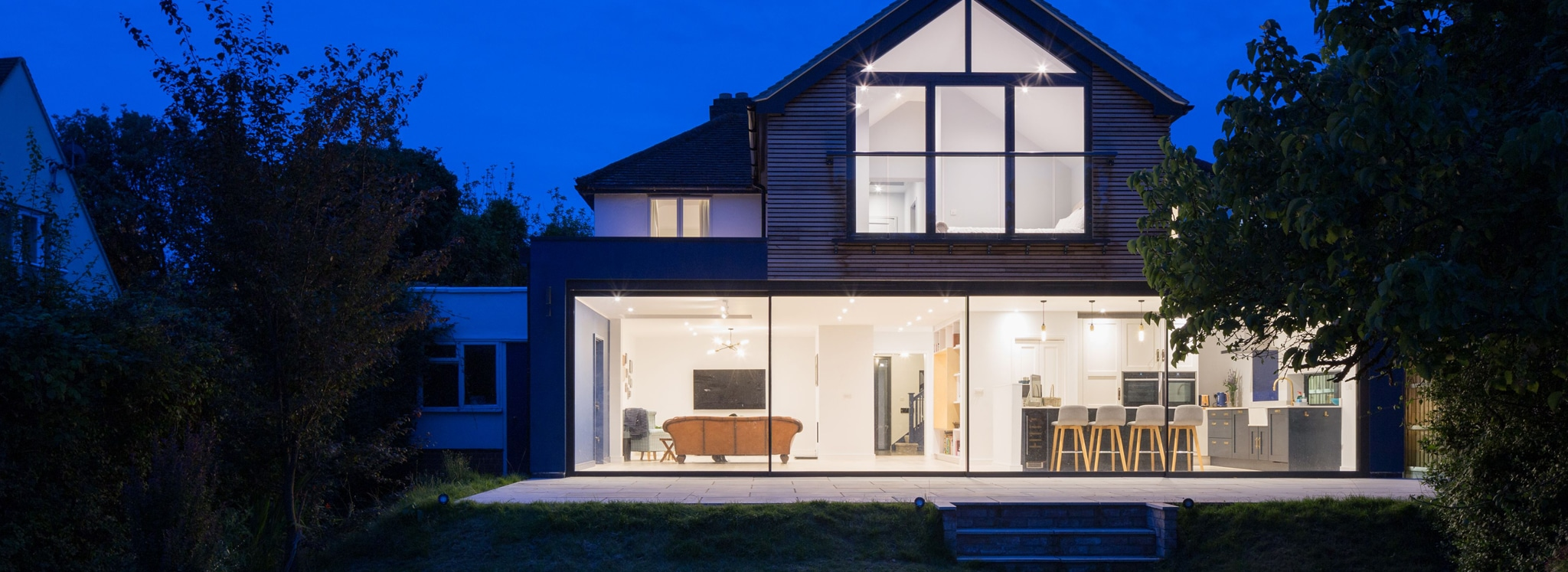 Large sliding doors in two-storey extension