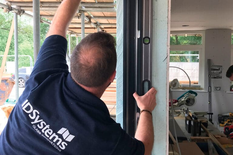 Installing sliding doors at the Build it Selfbuild Education House at Graven Hill in Bicester