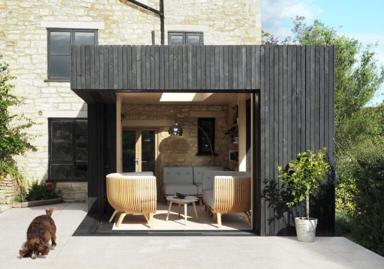 The Reading Room in Gloucestershire featuring open corner sliding doors which slide into a pocket