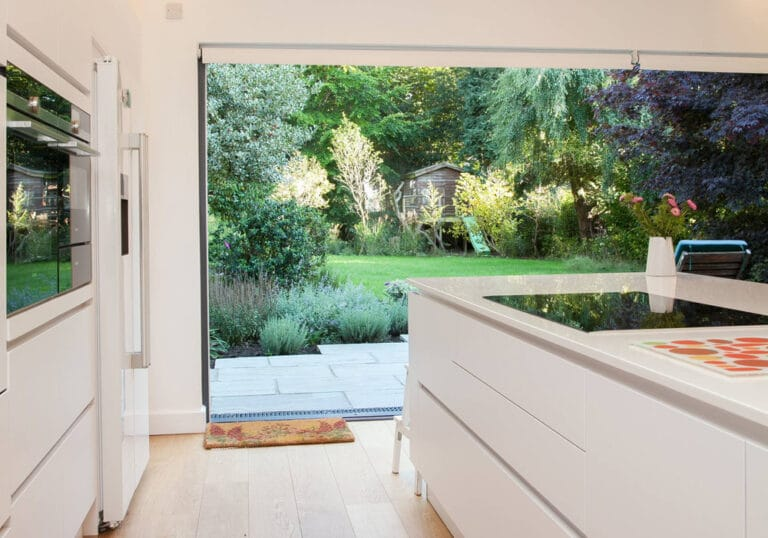 Open pocket sliding doors provide seamless transition between inside and out