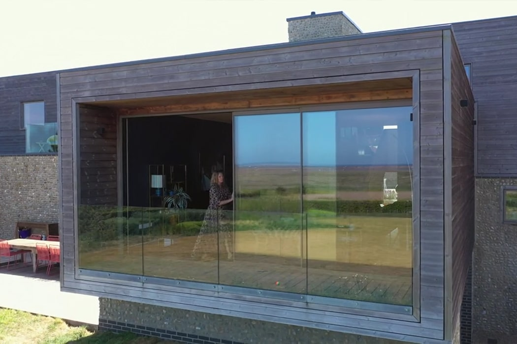 IDSystems theEDGE2.0 sliding doors - large 3-panel set of sliding doors open up the house onto a balcony