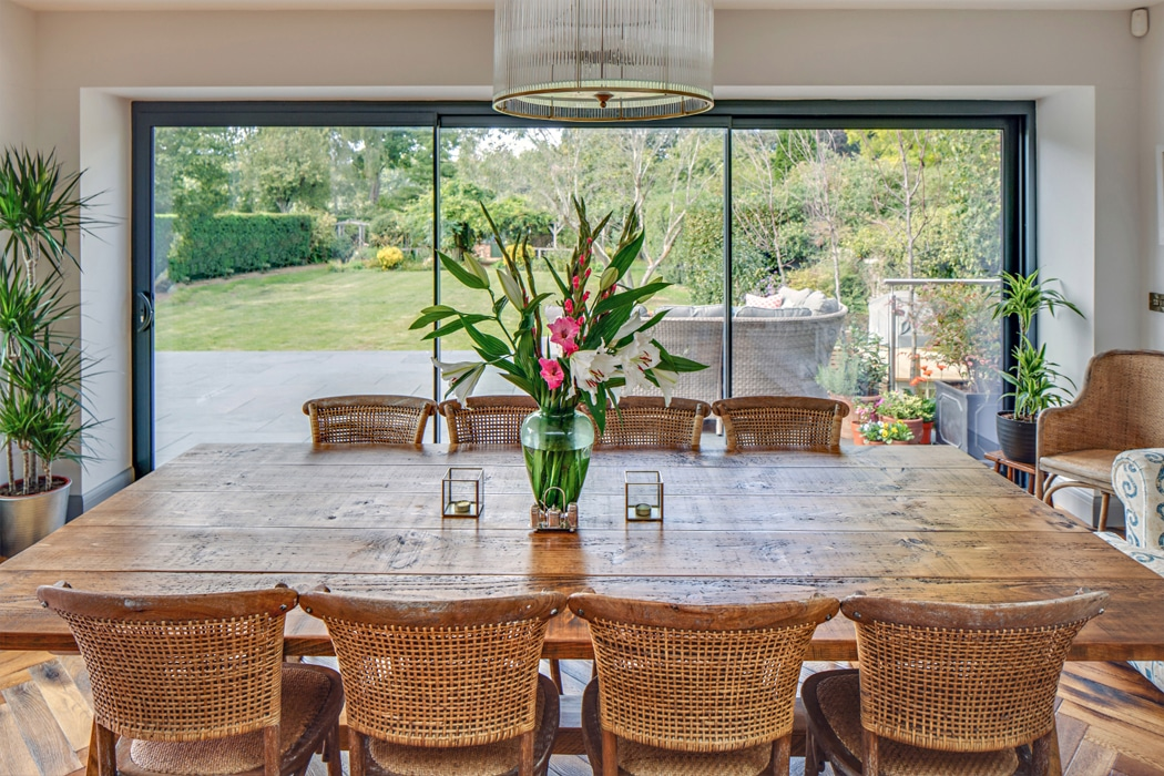 IDSystems theEDGE2.0 sliding doors - The narrow 20mm sightlines create an almost completely seamless wall of glass, making the most of the garden views