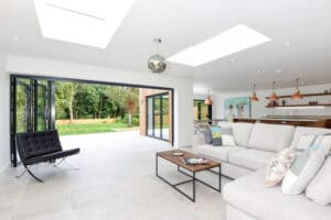 This large open plan living space and kitchen is connected with the patio thanks to three sets of SF55 bifold doors