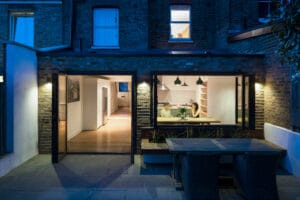 The kitchen of this North London extension extends out into the garden thanks to the bifold windows and doors, creating a stylish entertaining space