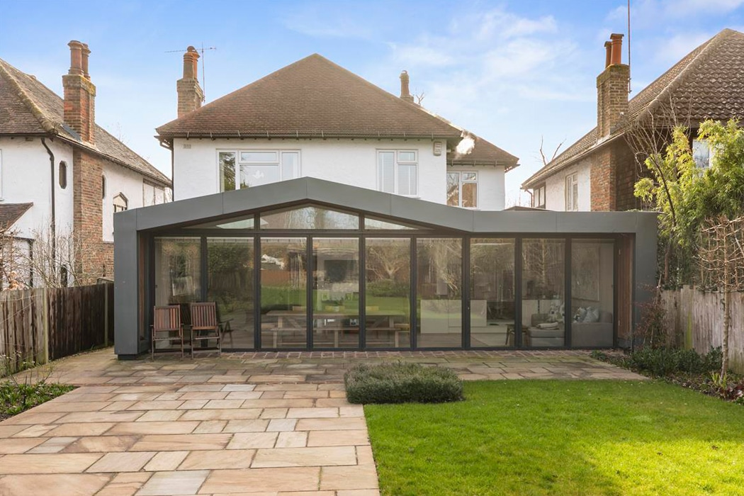 This stylish extension features 9-panels of the SF75 bifold doors across the entire rear elevation of this Surrey home