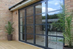 Aluminium bifold doors with horizontal bars, inspired by Art Deco styling of tradition steel doors