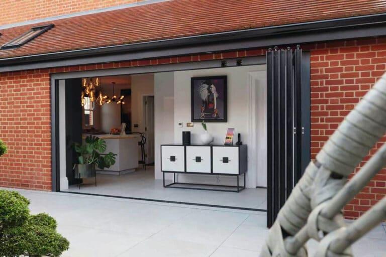 Red brick extension with vistaline slide & turn doors and courtyard garden
