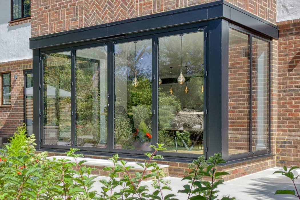 IDSystems SUNFLEX SF55 French doors with dummy door sidelights and fixed frame windows