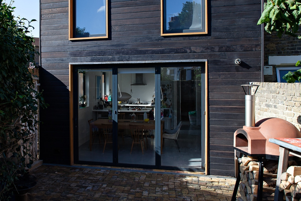 Are bifold doors a good idea? 3-panel bifold doors with black timber cladding